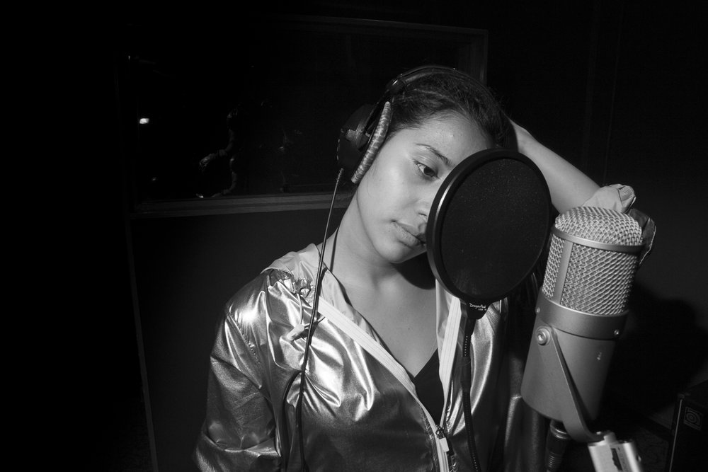 Studio shot by Lucas Hobbes O Neil- Tracking vocals for student projects.