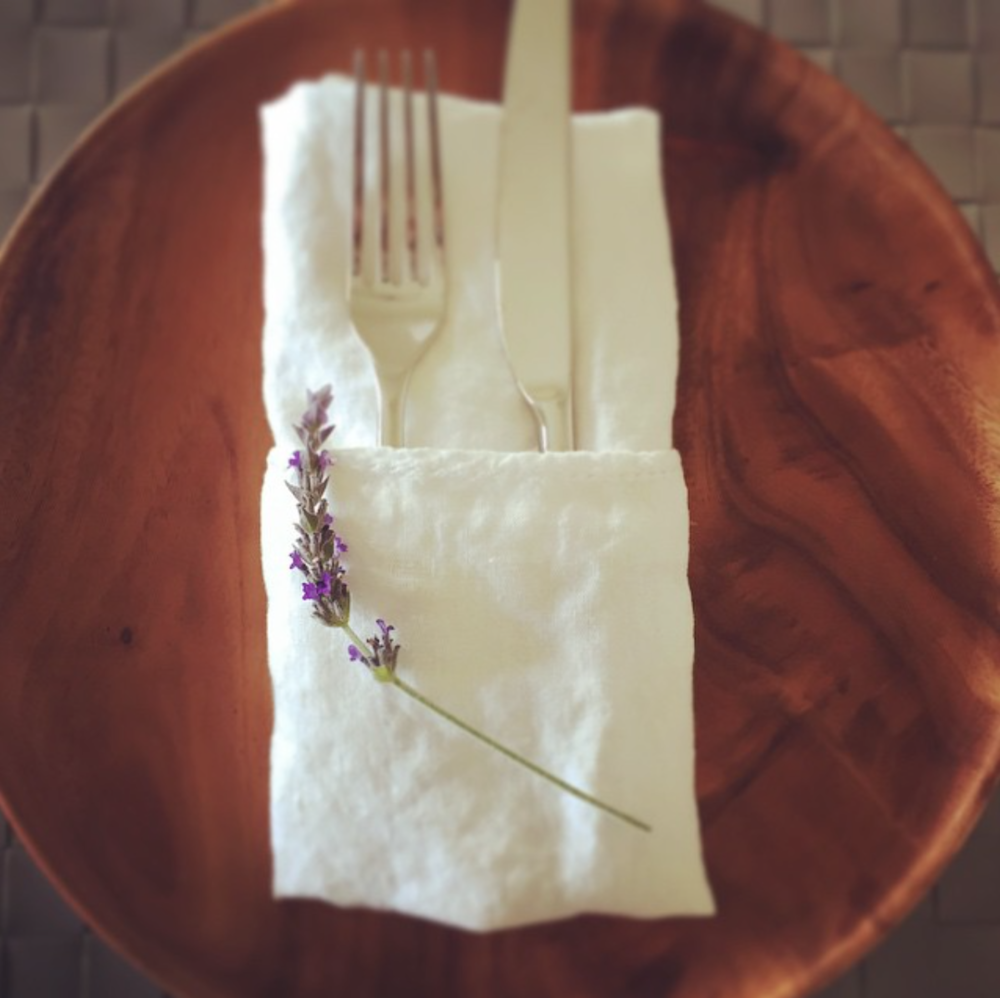 1. Table Settings - pocket fold your napkins and add an herb: sprig of rosemary, thyme, lavender for an added bonus.