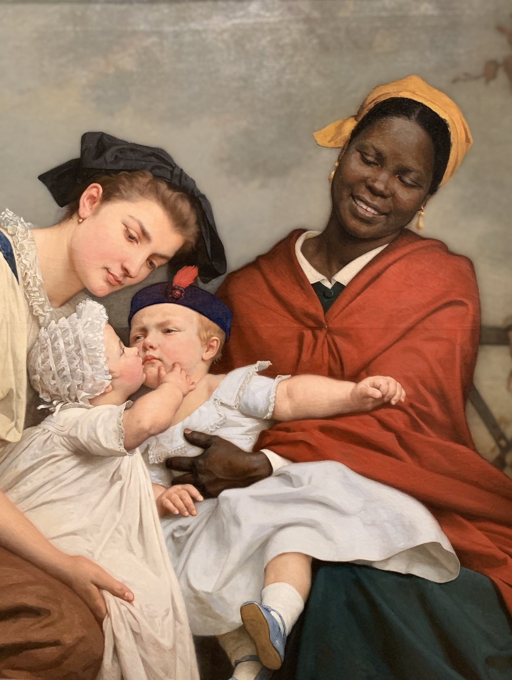 Two nannies and the children they're taking care of.This is one of my favorite images, it transmits so much warmth. The model on the right is not only seen as an equal to her white counterpart, but she carries the most weight in this painting. Her tall posture, warm smile, and the vibrant color of her skin and clothing standing out against the dull beige and grey background. She looks beautiful and regal. -