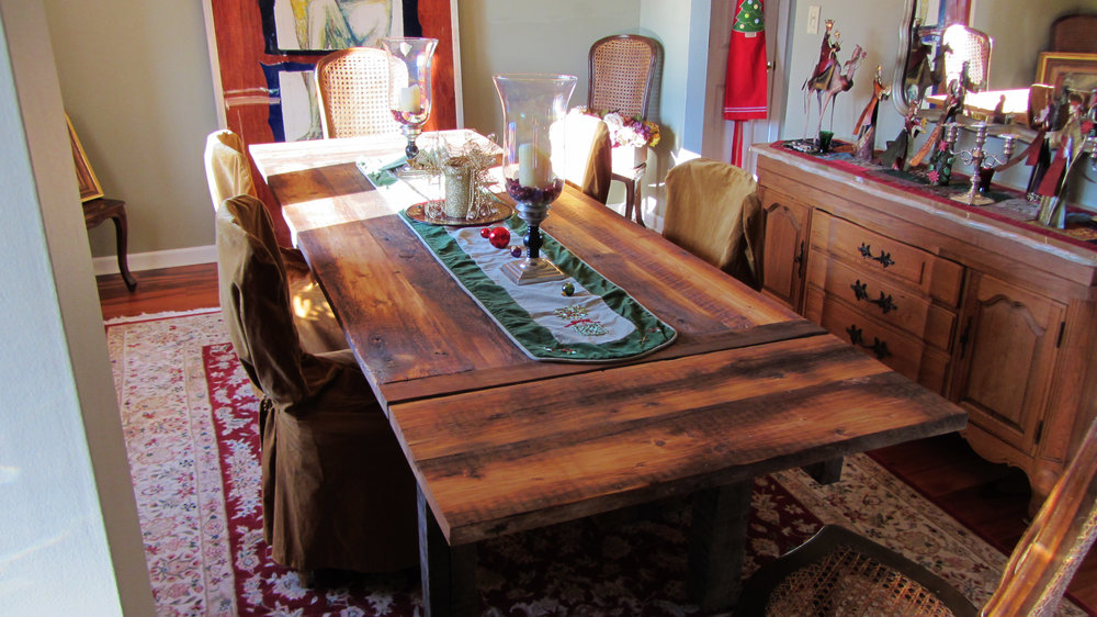 """Classic farm table with breadboard ends built from former framing timbers. Traditional apron and 4"""" reclaimed square oak legs. Drop-in leaves (pictured). Finished with food safe tung oil and paste wax. 36"""" x 84"""" x 30""""."""