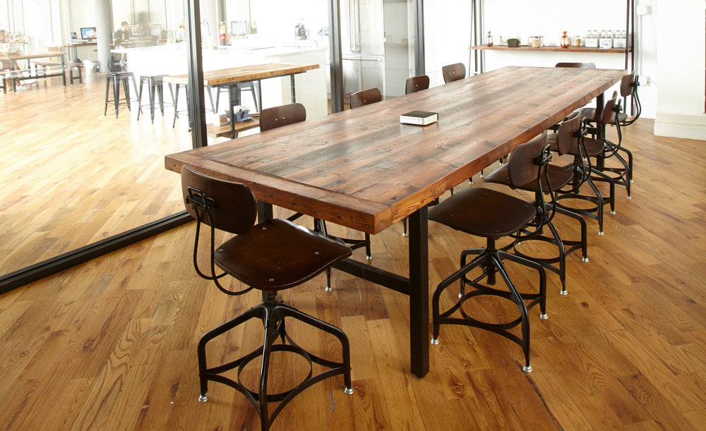 """Conference table with breadboard ends,built from former framing timbers. Metal black powder-coated legs provide a contemporary accent. Finished with clear lacquer and paste wax. 40"""" x 138"""" x 30""""."""