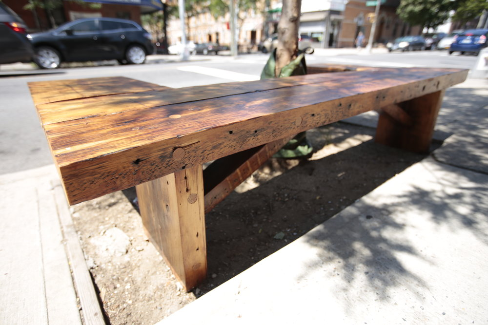 """Outdoor benches for Cypress Inn Cafe built from former framing timbers. Undercarriage support beams provide strength and style. Finished with Spar Urethane. Wrap-around bench: 42"""" x 85"""" x 18""""."""
