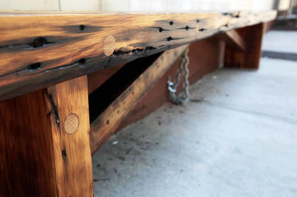 """Outdoor benches for Cypress Inn Cafe built from former framing timbers. Undercarriage support beams provide strength and style.  Finished with Spar Urethane.  Long bench: 16"""" x 132"""" x 18""""."""