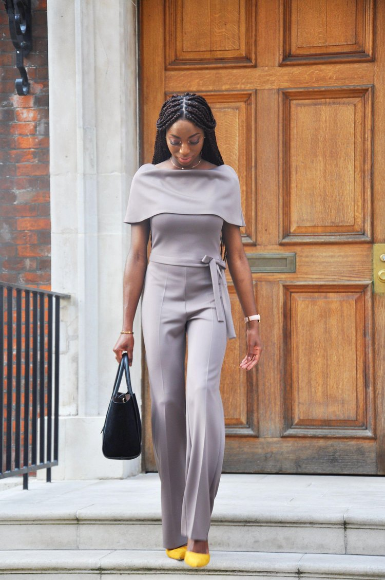 THE AIDA JUMPSUIT  With a detachable cape and waist belt, the AIDA JUMPSUIT has an array or ways to be worn and paired. Dress it up or dress it down.  Photography by K-Reuben.