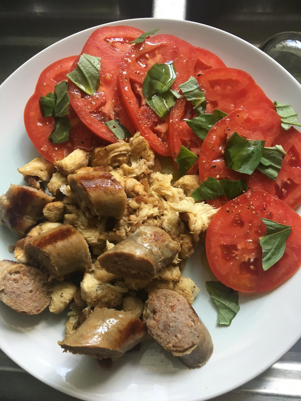 Lion's Mane sautéed with Savannah River Farms sausage and local organic tomatoes and Canewater Farm organic basil for lunch.
