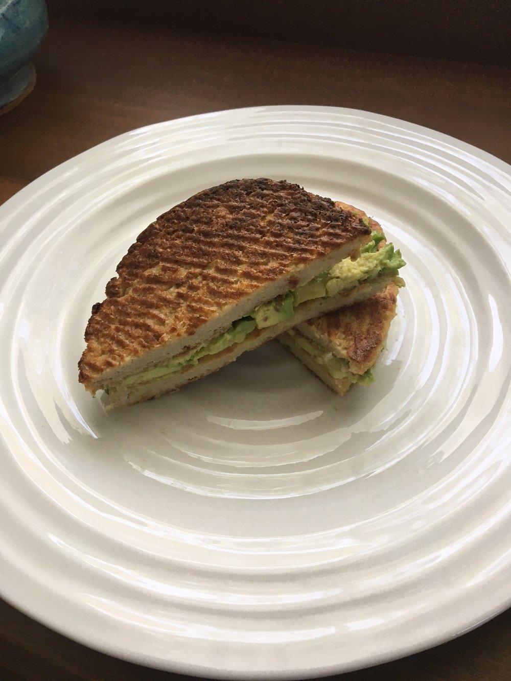 "Smashed avocado cauliflower ""grilled cheese"" sandwich."