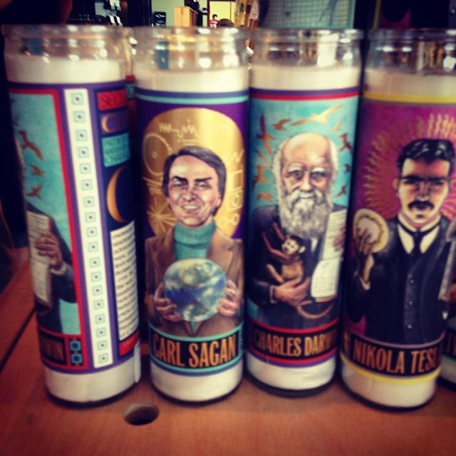 Carl Sagan saint candle, exploration gift shop.