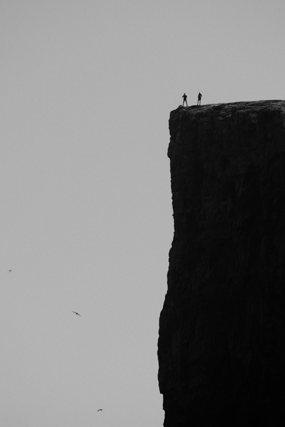 I saw these two on the edge of the cliff at trælanípa above lake sørvágsvatn. thought they had a death wish at first getting so close to the edge. the next picture shows you what they were looking at and what I eventually hiked to
