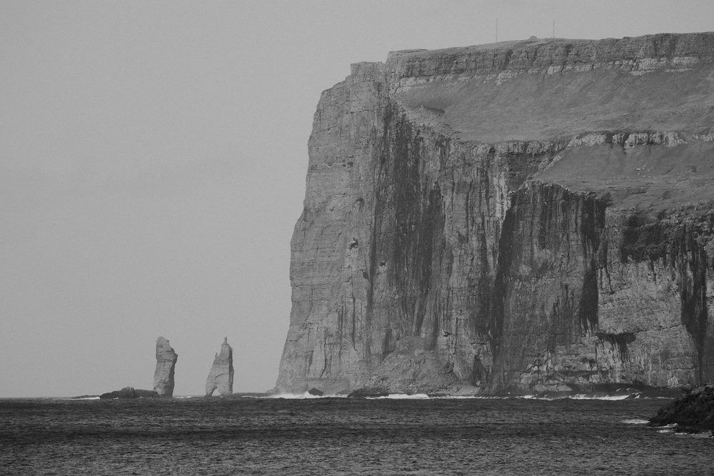 the sea stacks of risin og kellingin. the one on the left is the giant and on the right is the witch