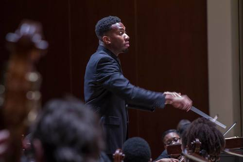 Conductor Bae conducting. (RoderickCox.com)