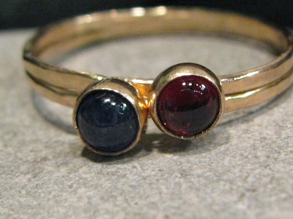 14k blue sapphire and garnet hammered stack ring set