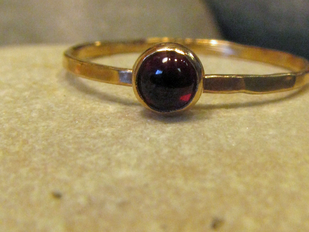 14k gold ring with natural garnet.