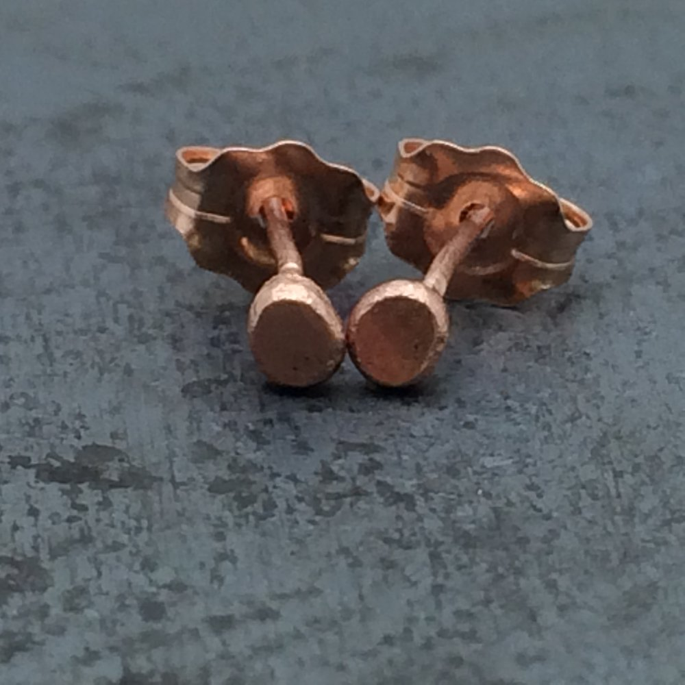 14k rose gold hammered pebble studs.jpg