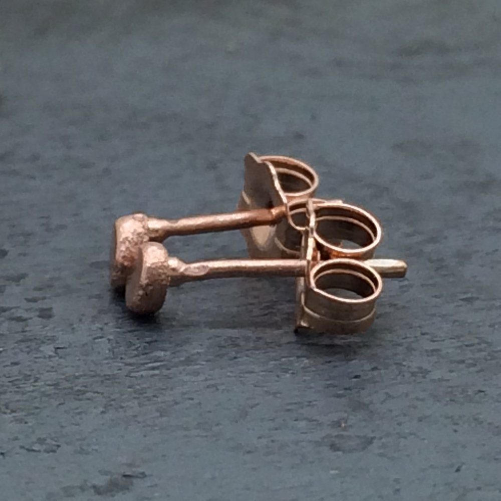 14k rose gold hammered pebble studs side view.jpg