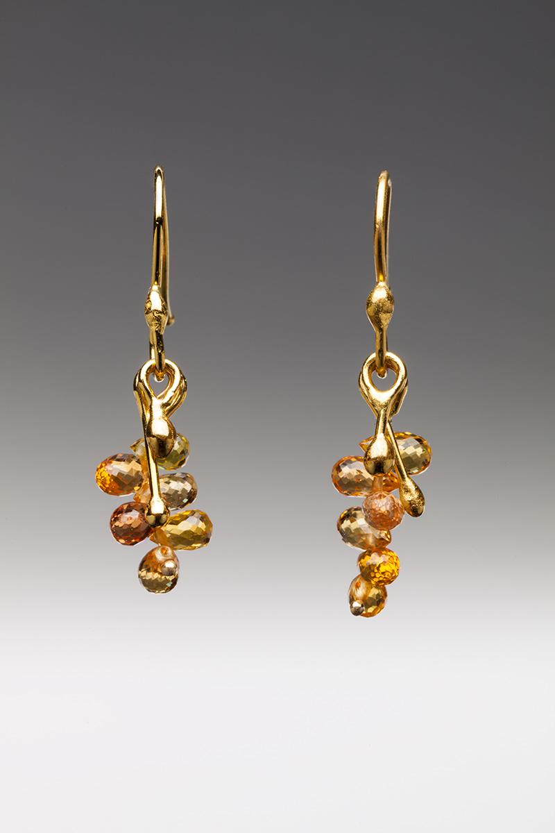 22k gold and orange sapphire earrings.