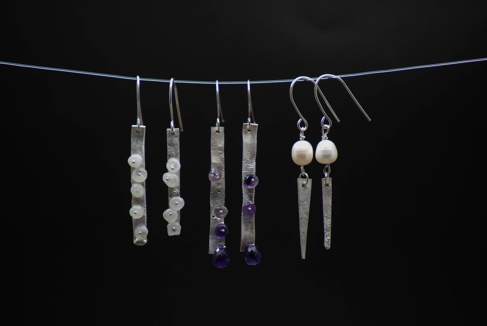Sterling Silver Earrings with rainbow moonstone (left), amethyst (middle), and cultured freshwater pearl (right).