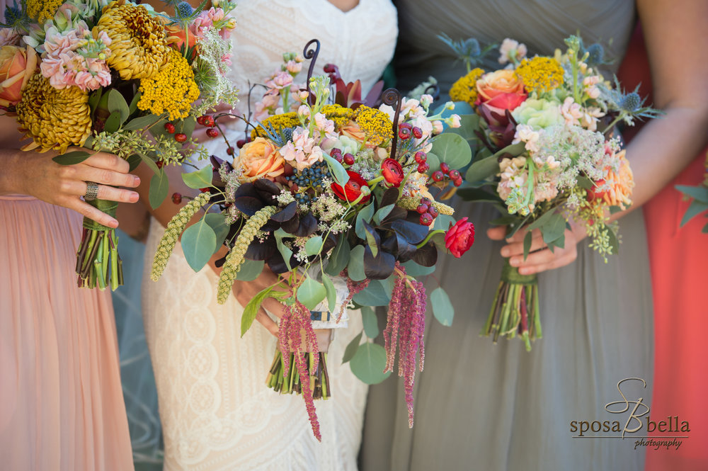 "Can you say ""wow""! Adina with Frilly Bloomers incorporated bright and muted tones to create these beautiful bouquets that set the tone for this Fall wedding."