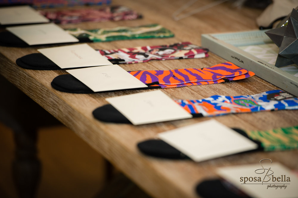 Each groomsman was given a pair of socks to show off each of their different personalities. This is a great way to add a little personalization to the groomsmen attire.