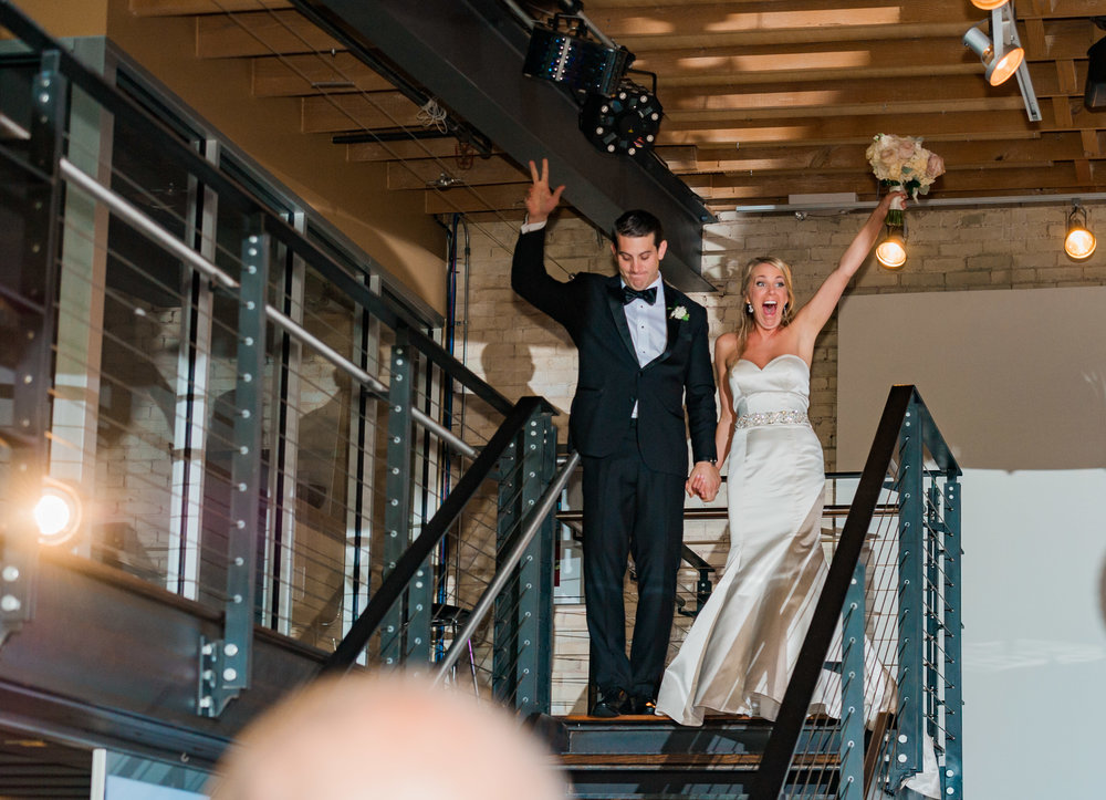 "Mark & Ashley danced their way into the reception with ""Sign, Sealed, Delivered - I'm Yours!"" by Stevie Wonder"