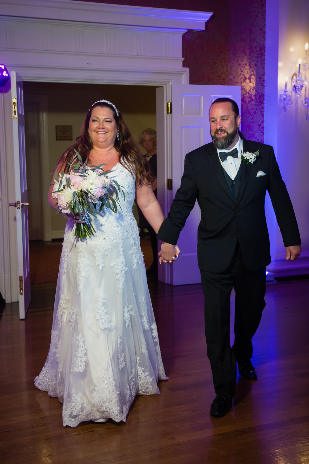 "Kim & Mark made their grand entrance into the color-filled room and began their long awaited first dance as husband & wife. They chose the classic ""You're My Home"" by Billy Joel."