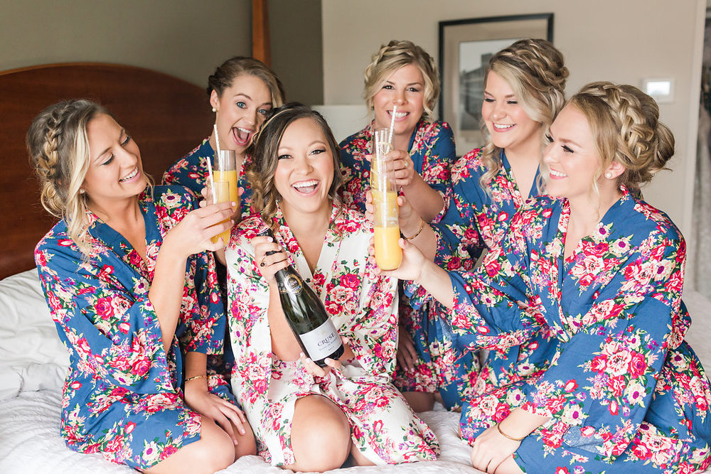 Josie and her bridesmaids prepping for the big day by poppling bottles!