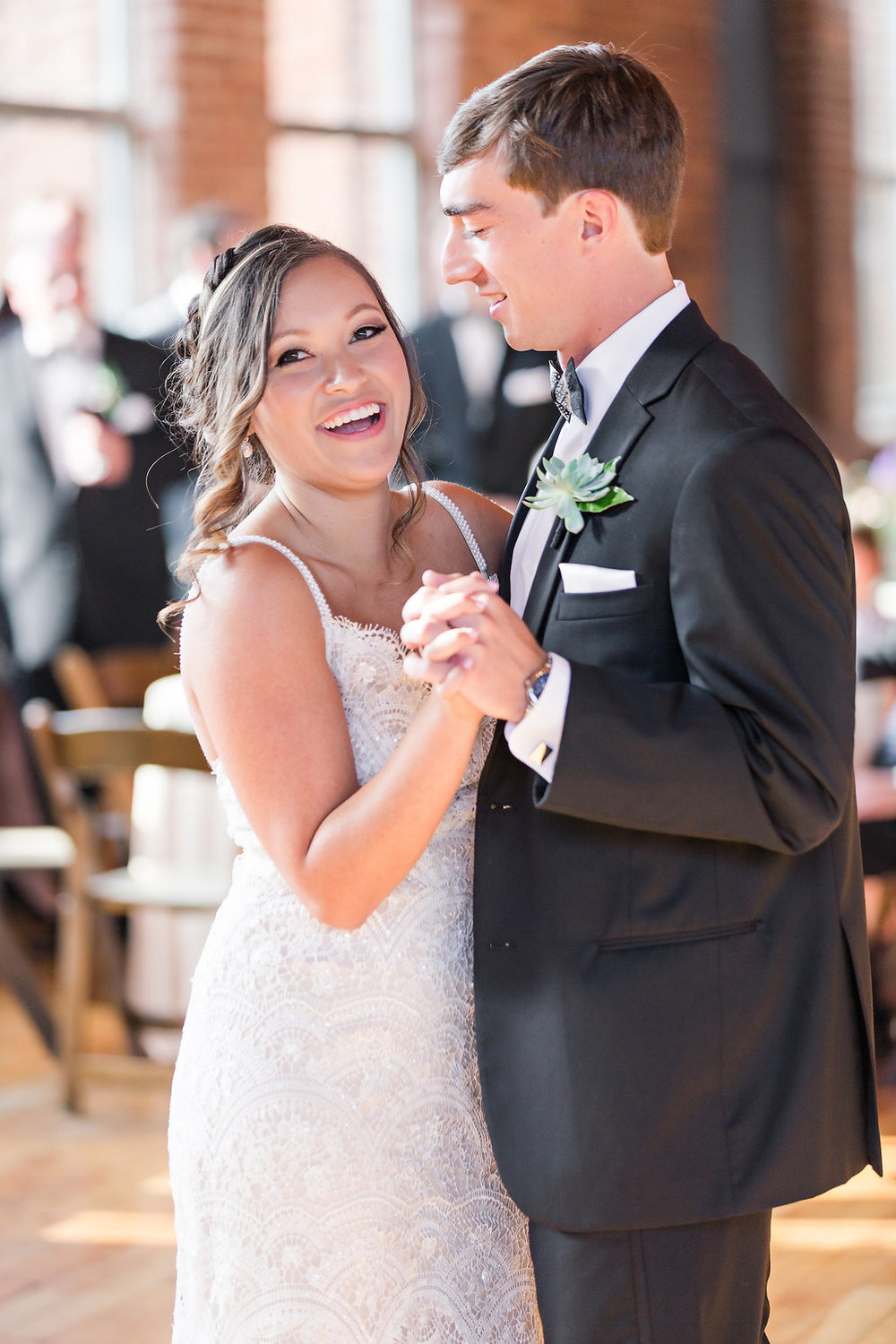 "Their first dance was to Tom Petty's ""Wildflowers"". A unique and perfect song for their first dance."