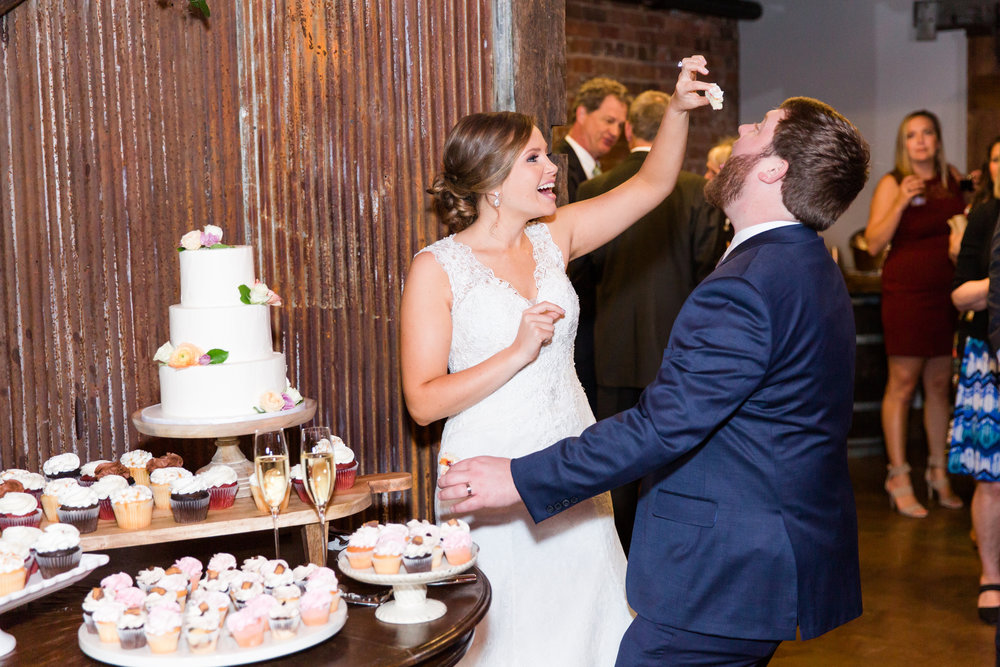 Megan and Ben enjoying some delicious cake from Couture Cakes. Susan is extremely talented at wedding cake design. She can really do anything with a cake!