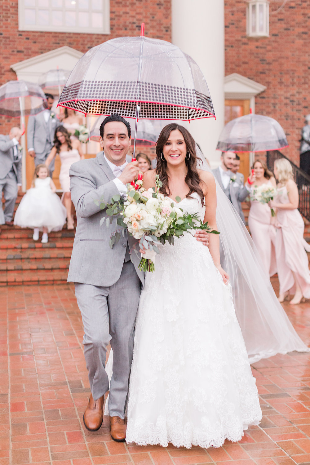A couple rain showers weren't going to put a damper on Amy and AC's wedding day.