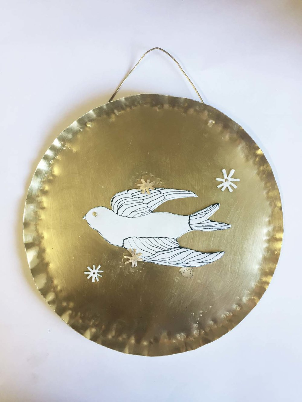 Riveted the bird with hand -cut metal stars, it took a lot of time placing the stars!