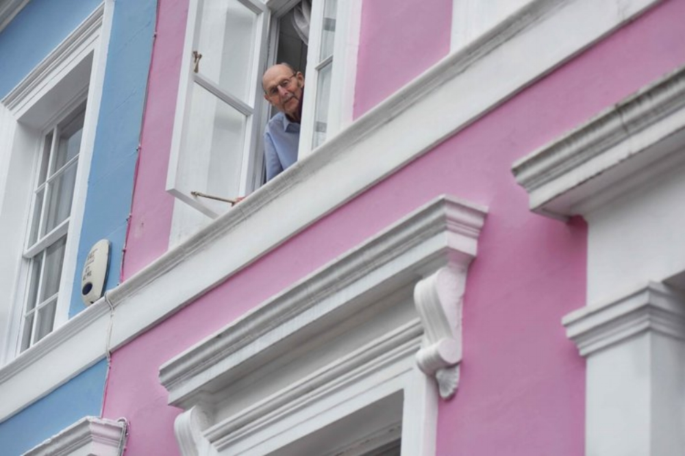 Man looking out of his appartment, Notting Hill, London, U.K. Image©thingstodot.com