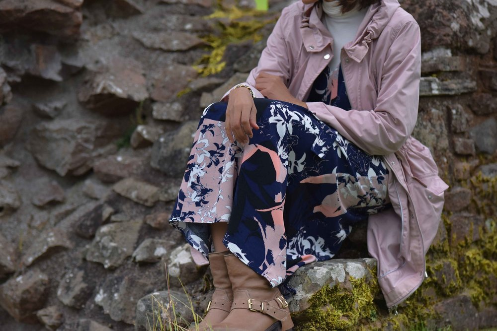 Pink Stormwear M&S  jacket, printed maxi dress, Ugg boots, Urquhart Castle, Loch Ness, Scotland. Image©thingstodot.com
