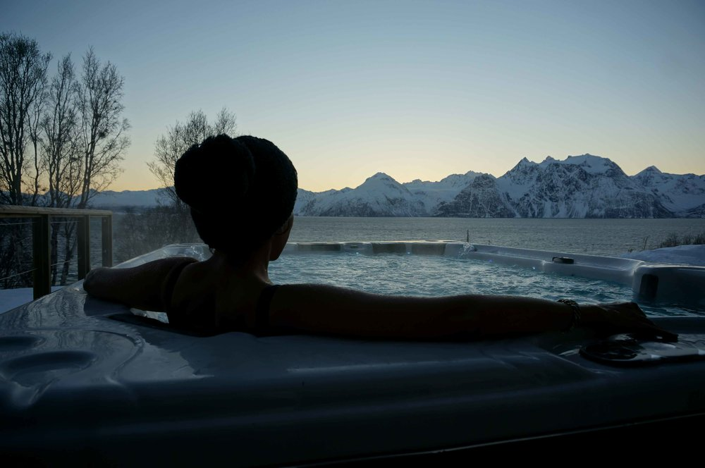 Arctic Spa, outside jacuzzi, Lyngen fjords, Lyngen Lodge, Arctic Circle, Norway. Image©thingstodot.com