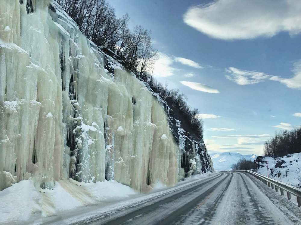 Driving in the fjords in Norway, Arctic Circle, mountains covered with icicles. Image©thingstodot.com