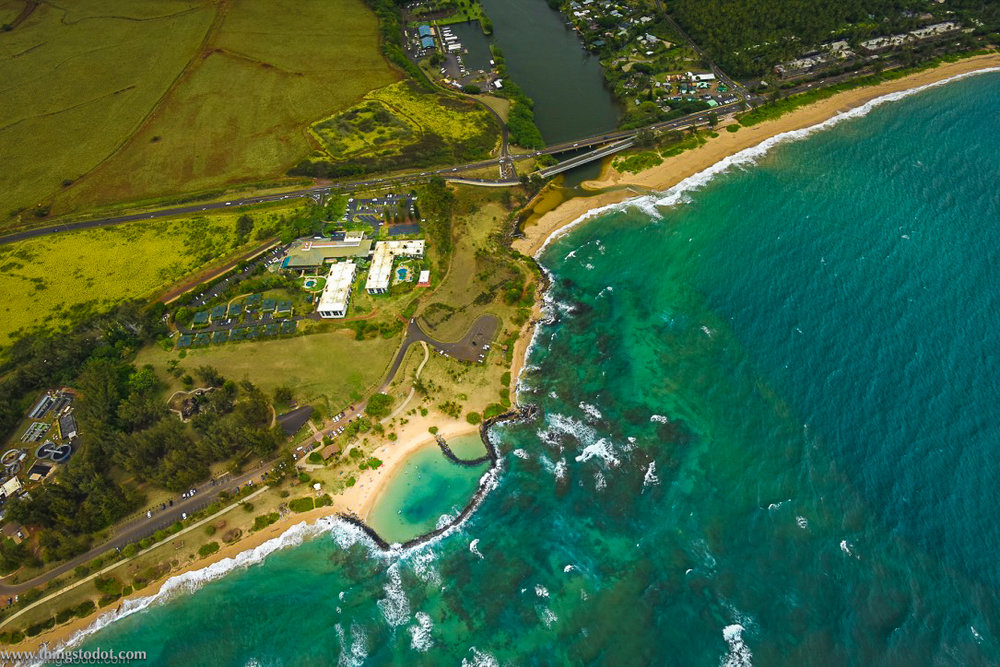 Aerial view of Lydgate Beach Park, Hilton Garden Inn & Wailua river, Kauai, Hawaii. Image@www.thingstodot.com
