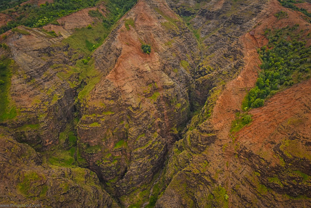 Waimea Canyon, Kauai, Hawaii, aerial view, Jack Harter Doors Off Helicopter Tour.Image©www.thingstodot.com