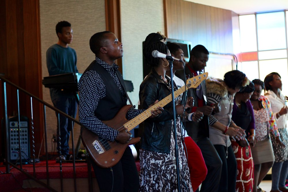 Solomon (with bass guitar) and the choir