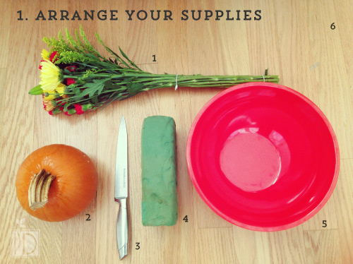 Arrange your supplies – 1) flowers, 2) pumpkin, 3) knife, 4) flower sponge, 5) bowl of water, and 6) cutting board.