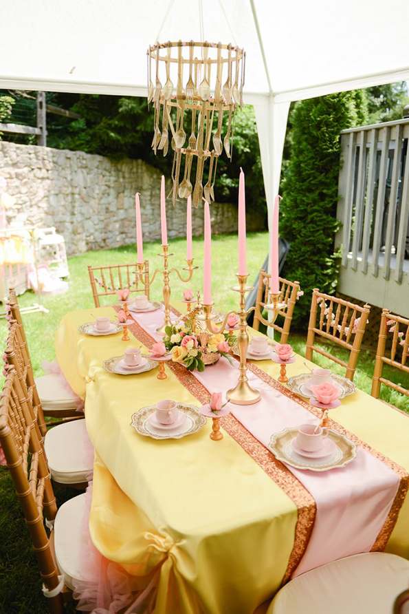 Welcome Belle to your party with candelabras, roses, and gold chiavari chairs.