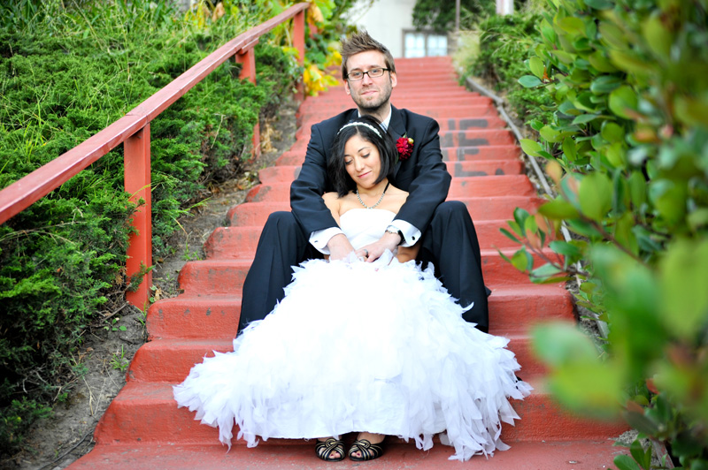 Bride and Groom sitting on stairs near Lake Merritt in Oakland, CA