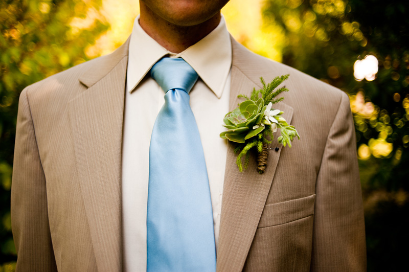 Detail of Groom with succulent boutonniere