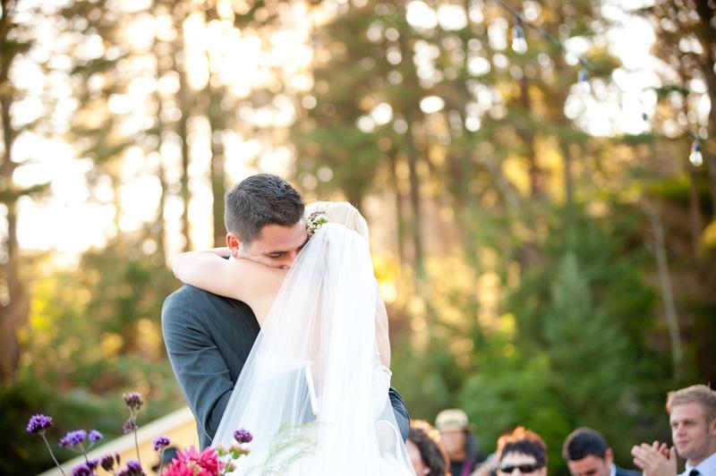 Bride and Groom embrace after wedding ceremony at Mar Vista Cottages