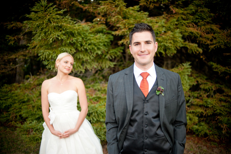 Portrait of Groom with out of focus bride