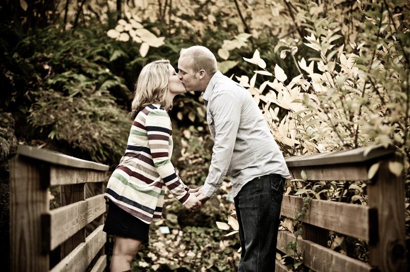 Couple kissing on wooden bridge