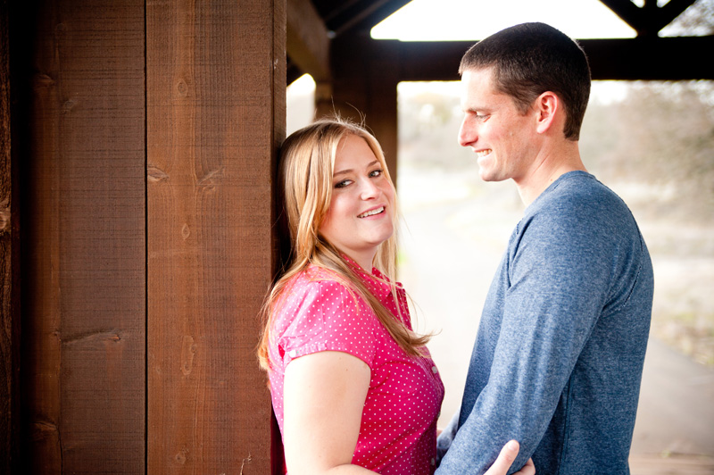 Couple facing each other under covered bridge in Fairfield, CA
