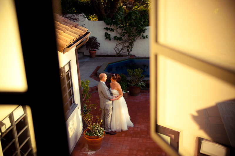 Bride and groom together in courtyard at home in Berkeley, CA