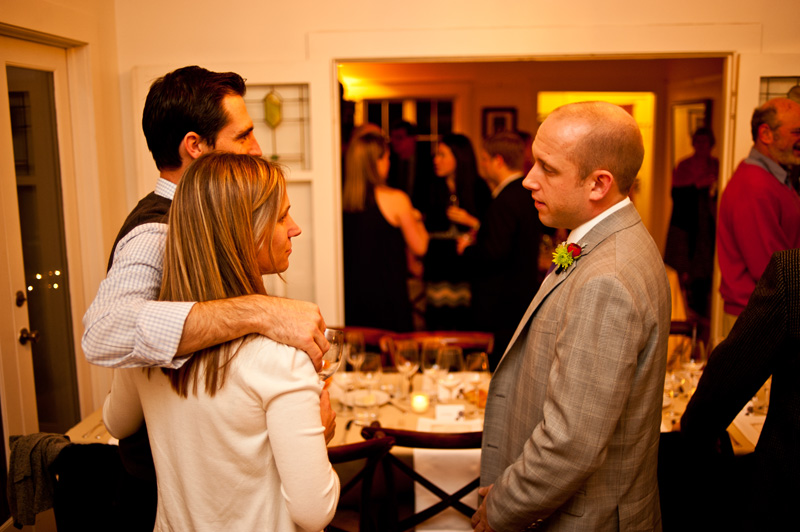 Groom socializing with guests in Oakland, CA