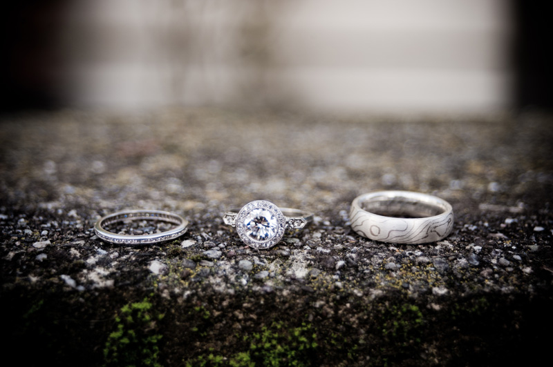 Wedding rings on moss covered stone