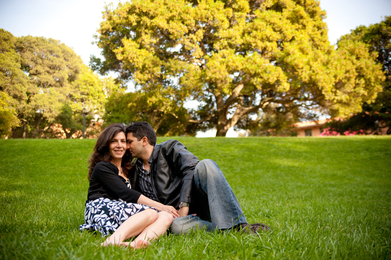 Couple sitting on grass at Faculty Glade