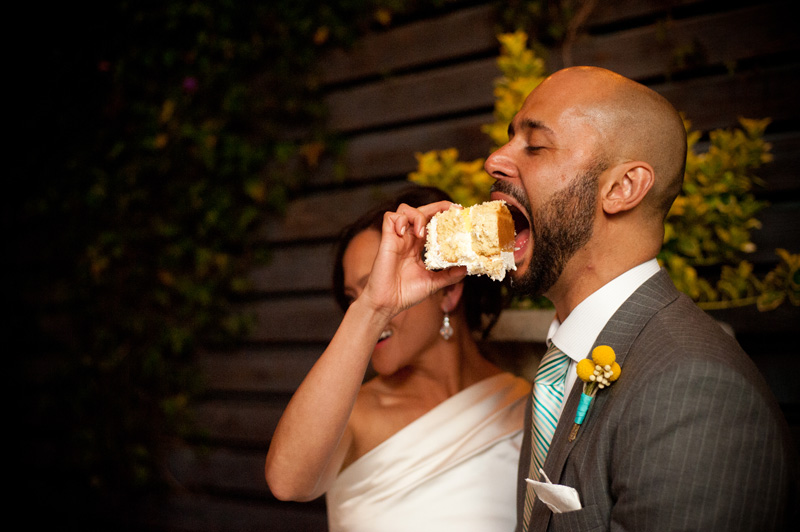Bride feeding groom wedding cake