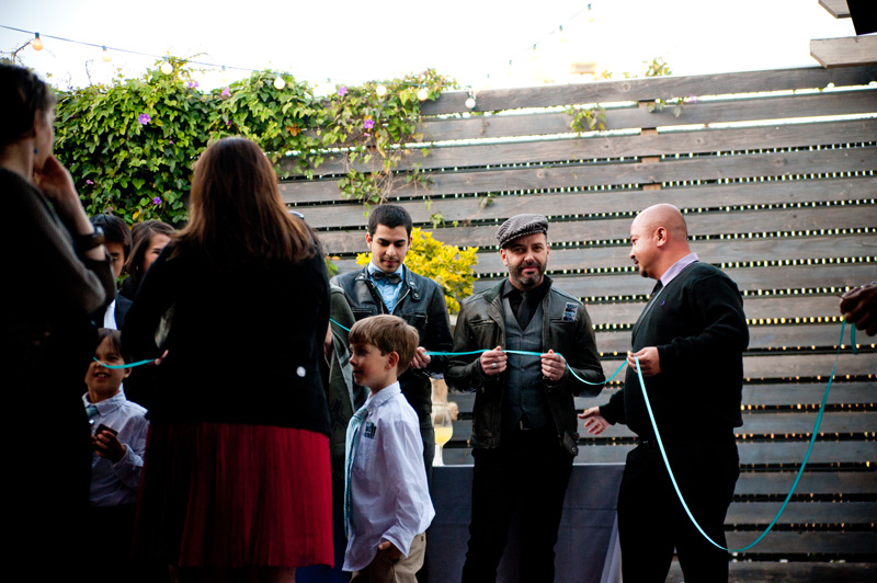 Guests holding ring warming string